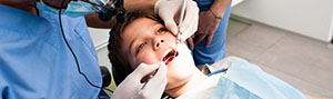 Young boy receiving dental treatment